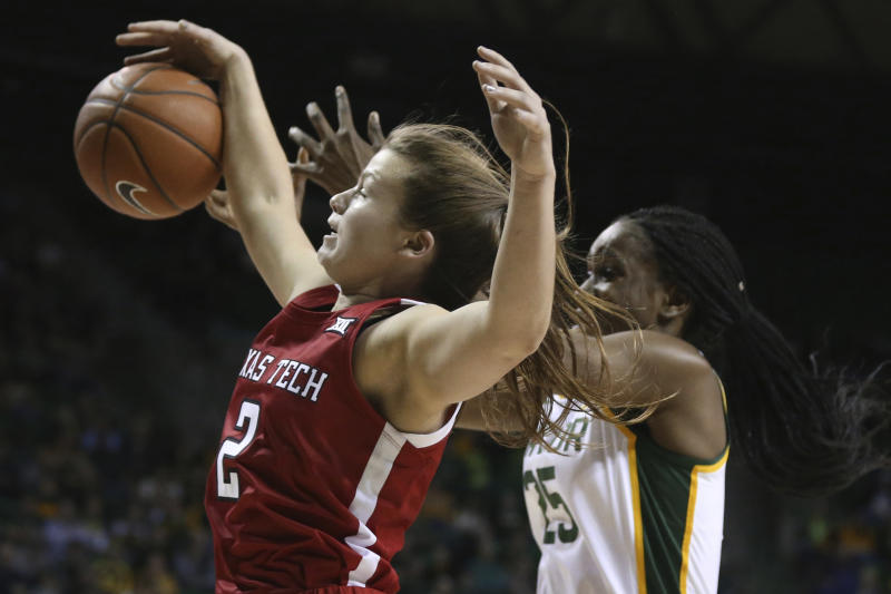 Texas Tech guard Sydney Goodson, left, grabs a rebound over Baylor center Queen Egbo, right, in the first half of an NCAA college basketball game, Saturday, Jan. 25, 2020, in Waco Texas. (AP Photo/Rod Aydelotte)