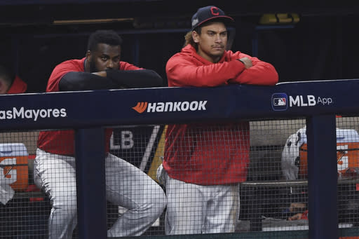 Cleveland Indians' Josh Naylor, right, and Franmil Reyes watch from the dugout after the Indians lost 10-9 to the New York Yankees in Game 2 of an American League wild-card baseball series, early Thursday, Oct. 1, 2020, in Cleveland. (AP Photo/David Dermer)