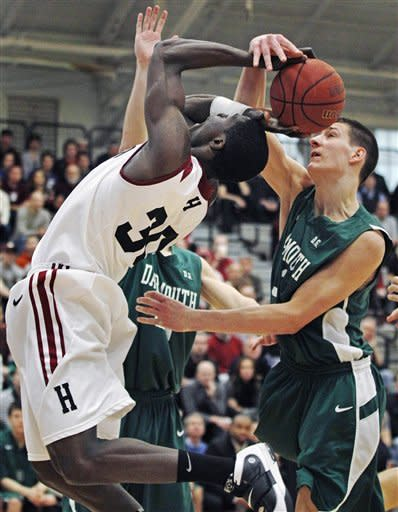 Harvard forward Kyle Casey, left, tries to hang on to the rebound as Dartmouth forward Gabas Maldunas, right, strips the ball in the first half during an NCAA college basketball game in Cambridge, Mass., Saturday Jan. 7, 2012. (AP Photo/Charles Krupa)