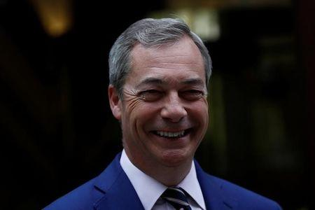 Nigel Farage, former leader of UKIP and anti-EU campaigner leaves Millbank studios in central London