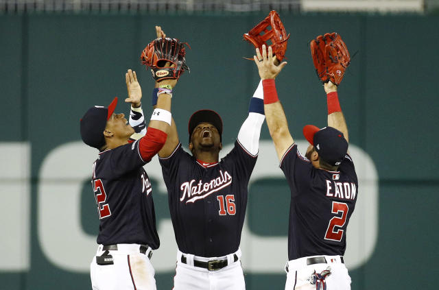"""FILE - In this June 4, 2019, file photo, Washington Nationals outfielders Juan Soto, from left, Victor Robles and Adam Eaton celebrate after beating the Chicago White Sox 9-5 in an interleague baseball game in Washington. For the 2019 Nationals, Game No. 60 on June 4, 2019, served as something of a microcosm of the whole season and an example of their """"Stay in the fight"""" mindset instilled by manager Dave Martinez. (AP Photo/Patrick Semansky, File)"""