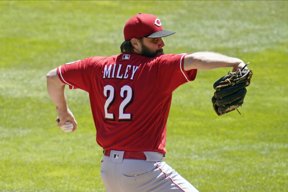 Cincinnati Reds pitcher Wade Miley (22) throws against the Minnesota Twins in the first inning of a baseball game, Tuesday, June 22, 2021, in Minneapolis. (AP Photo/Jim Mone)