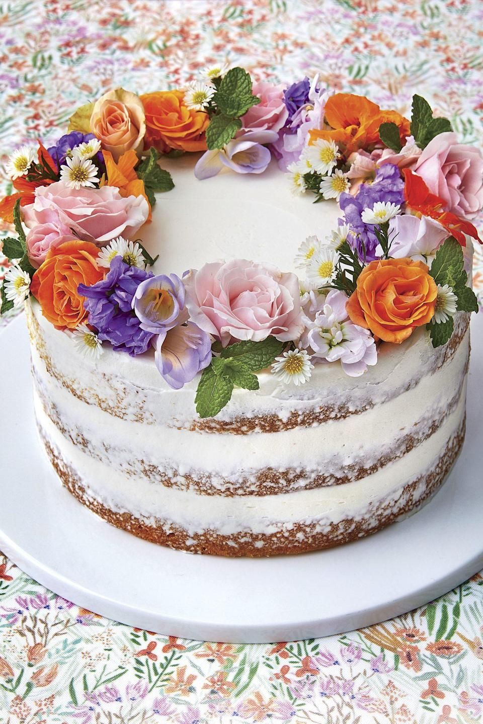 """<p>Perfect for birthdays, showers, or <a href=""""https://www.southernliving.com/desserts/cakes/party-cakes"""" rel=""""nofollow noopener"""" target=""""_blank"""" data-ylk=""""slk:special get-togethers"""" class=""""link rapid-noclick-resp"""">special get-togethers</a>, this flower-topped <a href=""""https://www.southernliving.com/desserts/cakes/layer-cakes"""" rel=""""nofollow noopener"""" target=""""_blank"""" data-ylk=""""slk:layer cake"""" class=""""link rapid-noclick-resp"""">layer cake </a>is so pretty you won't want to cut it! Made with a lemon cake mix and Lemon Buttercream frosting, it's incredibly simple to make, even though it looks impressive. Top with a ring of <a href=""""https://www.southernliving.com/food/entertaining/edible-flowers"""" rel=""""nofollow noopener"""" target=""""_blank"""" data-ylk=""""slk:edible flowers"""" class=""""link rapid-noclick-resp"""">edible flowers</a> and prepare for compliments.</p>"""