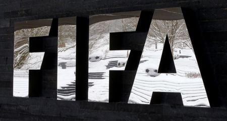 The snow-covered landscape is reflected in a logo in front of FIFA headquarters in Zurich, Switzerland, January 10, 2017.   REUTERS/Arnd Wiegmann - RTX2YA85