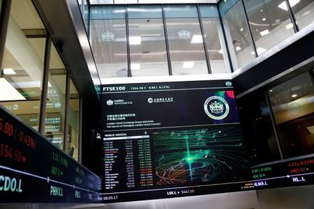 FILE PHOTO: A trading screen is seen following the opening of the markets by British Chancellor of the Exchequer Philip Hammond and Chinese Vice-Premier Hu Chunhua at  the London Stock Exchange in London