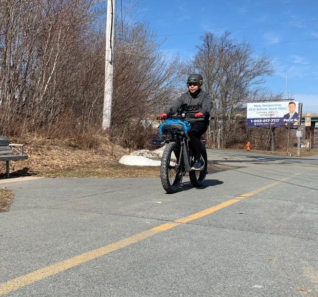 A cyclist rides on one of Halifax's bike trails Friday.  (Paul Palmeter/CBC - image credit)