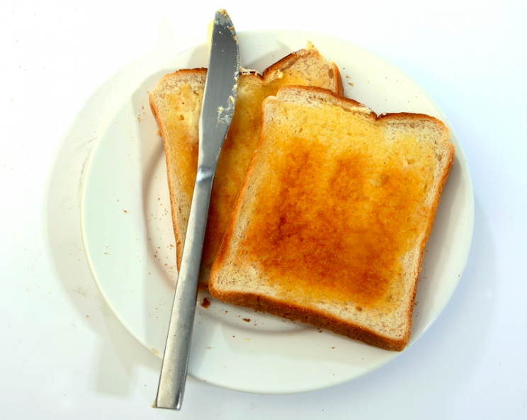 Guidelines: Experts advise cooking toast to a golden colour (Rex)