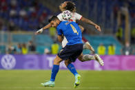 Italy's Leonardo Spinazzola, foreground, duels for the ball with Switzerland's Kevin Mbabu during the Euro 2020 soccer championship group A match between Italy and Switzerland at the Olympic stadium in Rome, Italy, Wednesday, June 16, 2021. (AP Photo/Alessandra Tarantino, Pool)