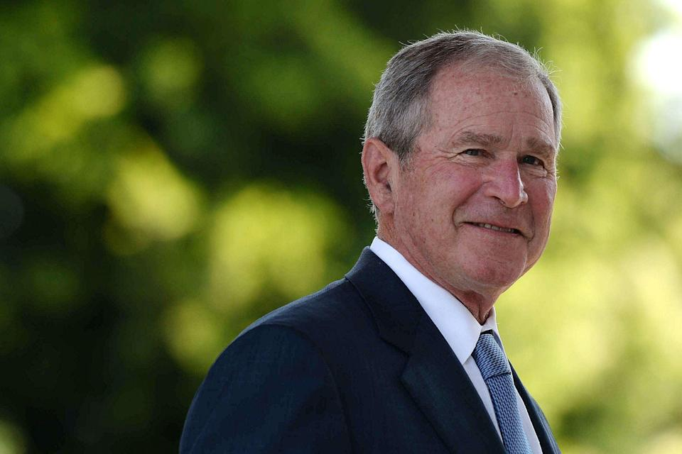 (FILES) In this file photo former United States of America President George W. Bush looks on upon his arrival at the Theresanyo Primary school, on April 4, 2017, in Gaborone, during a two day official visit in Botswana. - Republican former US president George W. Bush will attend the inauguration of Democrats Joe Biden and Kamala Harris in Washington on January 20, his chief of staff said Tuesday.