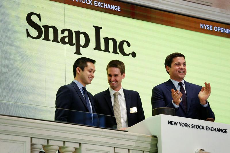 Snap cofounders Evan Spiegel and Bobby Murphy ring the opening bell of the New York Stock Exchange (NYSE) with NYSE Group President Thomas Farley shortly before the company's IPO in New York