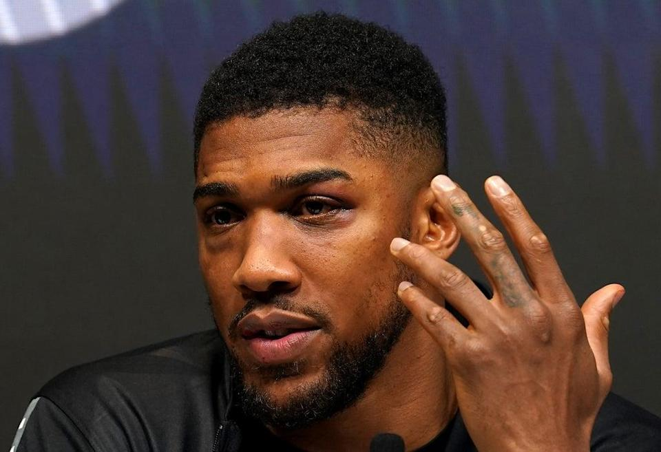 Anthony Joshua's battle scars were on show in his post-fight press conference (Nick Potts/PA) (PA Wire)