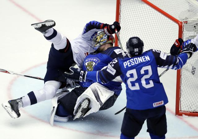 Ice Hockey - 2018 IIHF World Championships - Group B - Finland v USA - Jyske Bank Boxen - Herning, Denmark - May 15, 2018 - Anders Lee of the U.S. collides with goaltender Hari Sateri of Finland. REUTERS/David W Cerny