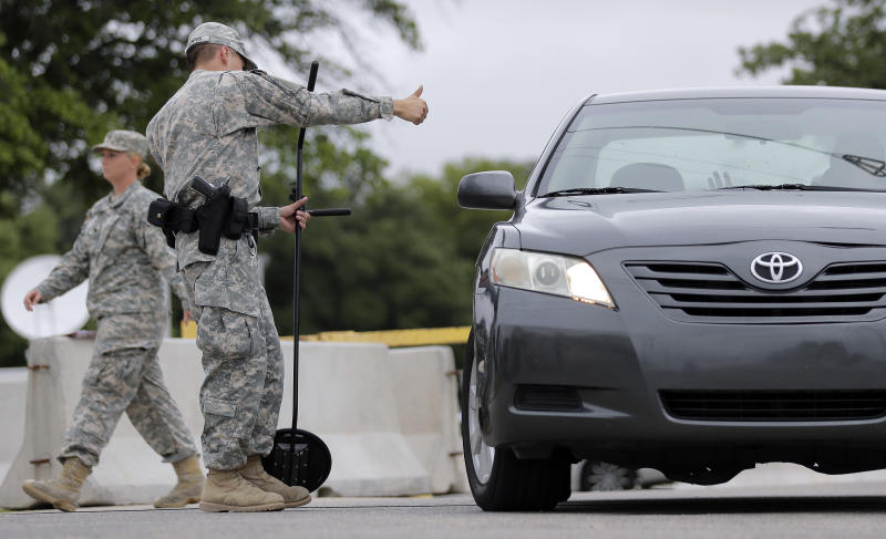 A driver gets the thumbs-up at a security checkpoint to enter the Lawrence William Judicial Center as the sentencing phase for Maj. Nidal Hasan continues, Tuesday, Aug. 27, 2013, in Fort Hood, Texas. Hasan was convicted of killing 13 of his unarmed comrades in the deadliest attack ever on a U.S. military base. (AP Photo/Eric Gay)