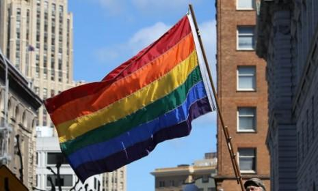 A man waves a gay pride flag in San Francisco: On Thursday, a New York court became the second federal court to rule that the Defense of Marriage Act, which designates marriage as between one man and one woman, is unconstitutional.