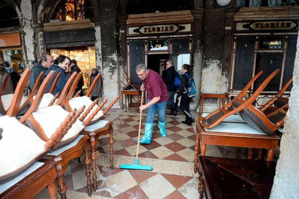 PHOTO: A man cleans water out of the historical Florian cafe, in Venice, Italy, Nov. 13, 2019. (NSA via AP, FILE)