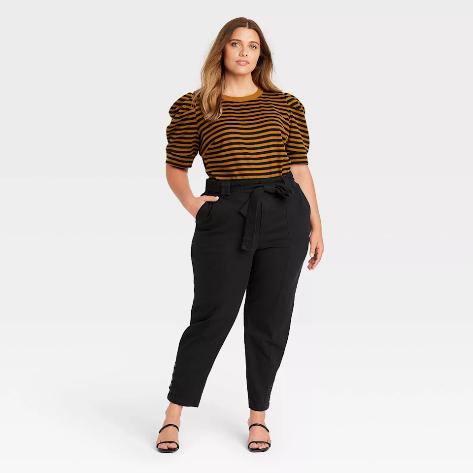 """<h2>Who What Wear Button Hem Ankle-Length Pants</h2><br>Target is known for killing the casual clothing game with impressive designer collabs. That means you can snag sophisticated pair of paper bag pants for less than $50. <br><br><em>Shop<strong><a href=""""https://goto.target.com/XxLgjX"""" rel=""""nofollow noopener"""" target=""""_blank"""" data-ylk=""""slk:Target"""" class=""""link rapid-noclick-resp""""> Target </a></strong></em><br><br><strong>Who What Wear</strong> Women's Button Hem Ankle Length Pants, $, available at <a href=""""https://go.skimresources.com/?id=30283X879131&url=https%3A%2F%2Fgoto.target.com%2FXxLgjX"""" rel=""""nofollow noopener"""" target=""""_blank"""" data-ylk=""""slk:Target"""" class=""""link rapid-noclick-resp"""">Target</a>"""