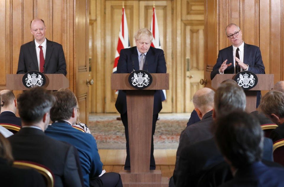 Britain's prime Minister Boris Johnson, centre, Chief Medical Officer for England Chris Whitty, left, and Chief Scientific Adviser Patrick Vallance speak as they hold a press conference at Downing Street on the government's coronavirus action plan in London, Tuesday, March 3, 2020. Johnson is announcing plans for combating the spread of the new COVID-19 coronavirus in UK.(AP Photo/Frank Augstein, Pool)