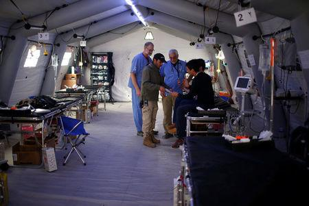 Foreign volunteer works at the emergency field hospital run by US Christian charity Samaritan's Purse in eastern Mosul