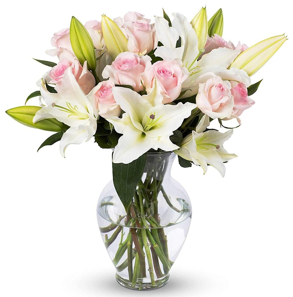 <p>Treat yourself or a loved one to these gorgeous perfect for spring <span>Benchmark Bouquets Light Pink Roses and White Oriental Lilies, With Vase</span> ($41).</p>