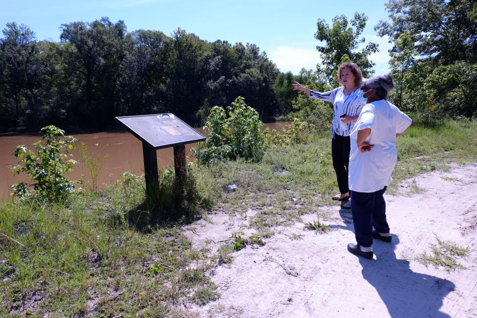 Kathy Andrews, left, speaks with Reatha Jefferson by the Great Pee Dee River Monday, Aug. 17, 2020 in Pamplico, S.C.. Andrews and Jefferson have rallied other town residents to oppose a 14.5-mile-long gas line proposal by Dominion Energy. (AP Photo/Michelle Liu)
