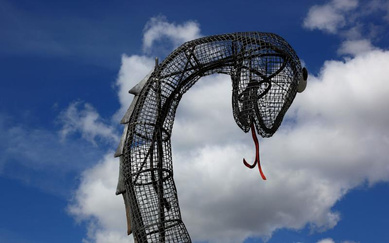 Nessie sculpture in Loch Ness - Getty Images Contributor