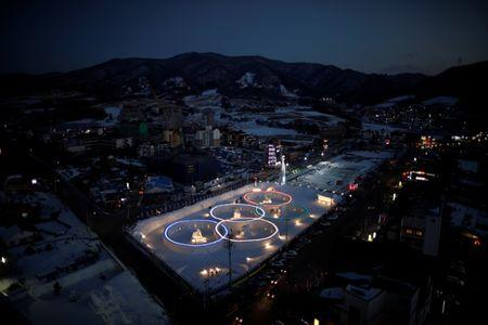 An ice sculpture of the Olympic rings is illuminated during the Pyeongchang Winter Festival
