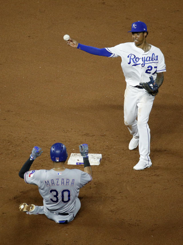Kansas City Royals second baseman Adalberto Mondesi (27) throws to first for the double play hit into by Texas Rangers' Adrian Beltre after forcing Nomar Mazara (30) out at second during the ninth inning of a baseball game Monday, June 18, 2018, in Kansas City, Mo. The Rangers won 6-3. (AP Photo/Charlie Riedel)