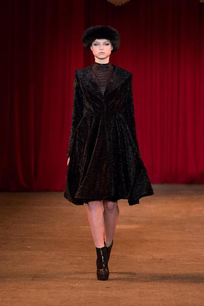 A model walks the runway during the Christian Siriano Fall 2013 fashion show during Fashion Week, Saturday, Feb. 9 2013, in New York. (AP Photo/Christian Siriano)