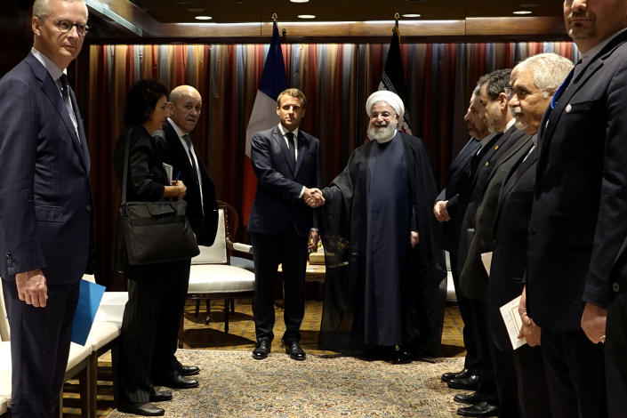 President Hassan Rouhani, right, shakes hands with French President Emmanuel Macron at U.N. headquarters on Sept. 24, 2019. (Photo: Iranian Presidency Office via AP)