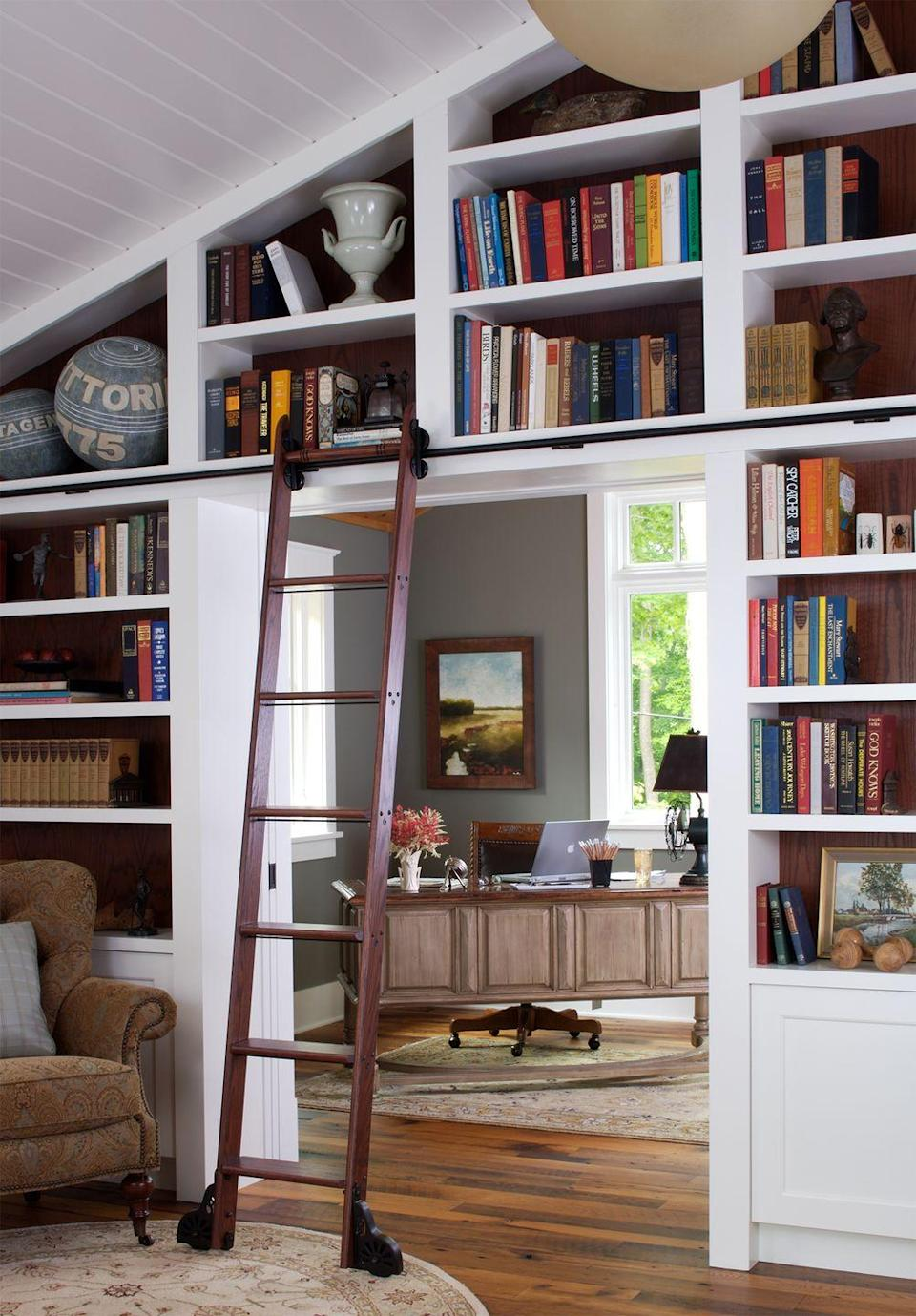 <p>A rolling library ladder removes the stress that comes along with navigating high bookshelves.</p>