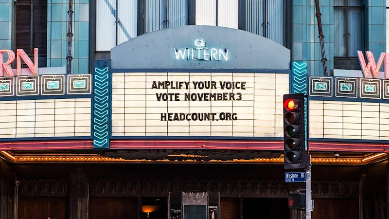 The marquee of the Wiltern in Los Angeles displays a voting message.