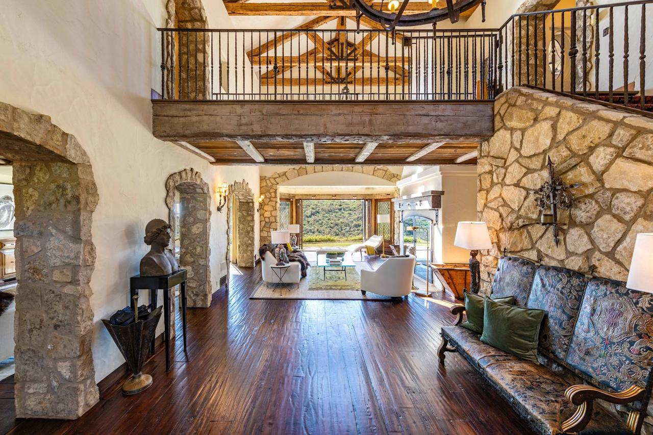 2) Exposed wood beams and stone-topped archways add character to the estate.