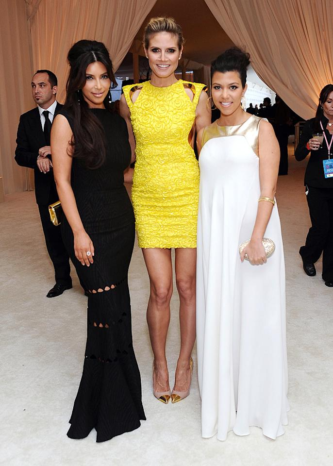 Kim opted for a gothic look in Alaia. Her sister, Kourtney, went Grecian in a Raoul gown, and both Kardashians nearly disappeared standing next to the super sexy Heidi Klum, who put them both to shame in her Versace mini and Louboutin pumps.