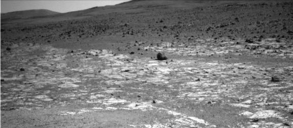 """This view from NASA's Opportunity Mars rover, taken on Aug. 3, 2013, shows an area where two geological units abut. The darker unit in the background, believed to be older, marks the edge of """"Solander Point,"""" a raised segment of the western rim"""