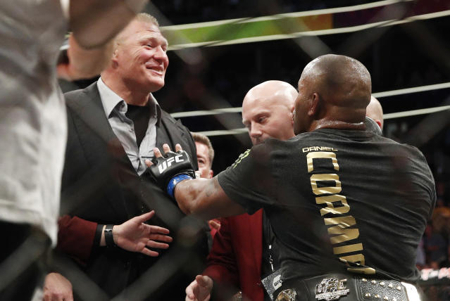 Brock Lesnar, left, taunts Daniel Cormier, after Cormier's heavyweight title mixed martial arts bout at against Stipe Miocic at UFC 226, Saturday, July 7, 2018, in Las Vegas. (AP Photo/John Locher)
