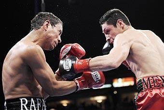 Israel Vazquez (right) connects with Rafael Marquez during the third round of their bout on March 1, 2008. Vazquez won in a split decision