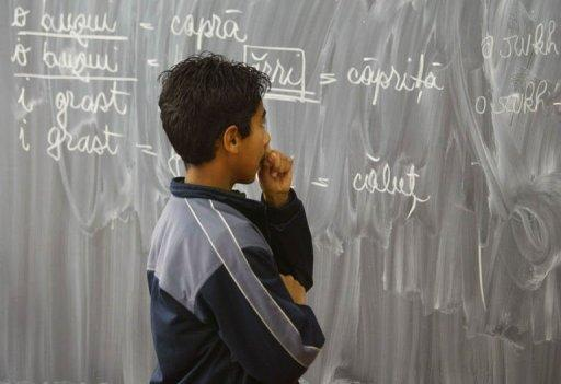 Lulu looks at a blackboard at a school in Bucharest's Ferentari district in 2003. One in two Romanian high school pupils failed their university exemption exams this year, a record low level after new anti-fraud measures cut back on cheating, new figures showed