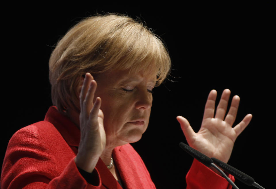 German Chancellor Angela Merkel gestures during a election campaign in the western town of Soest April 26, 2010.   REUTERS/Ina Fassbender (GERMANY - Tags: POLITICS ELECTIONS IMAGES OF THE DAY)
