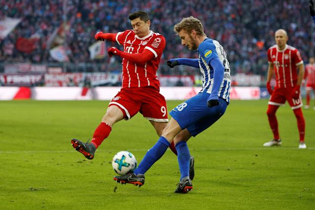 Soccer Football - Bundesliga - Bayern Munich vs Hertha BSC - Allianz Arena, Munich, Germany - February 24, 2018 Hertha Berlin's Fabian Lustenberger in action with Bayern Munich's Robert Lewandowski REUTERS/Michaela Rehle DFL RULES TO LIMIT THE ONLINE USAGE DURING MATCH TIME TO 15 PICTURES PER GAME. IMAGE SEQUENCES TO SIMULATE VIDEO IS NOT ALLOWED AT ANY TIME. FOR FURTHER QUERIES PLEASE CONTACT DFL DIRECTLY AT + 49 69 650050