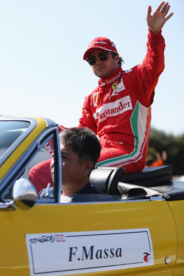 SUZUKA, JAPAN - OCTOBER 07:  Felipe Massa of Brazil and Ferrari attends the drivers parade before the Japanese Formula One Grand Prix at the Suzuka Circuit on October 7, 2012 in Suzuka, Japan.  (Photo by Mark Thompson/Getty Images)