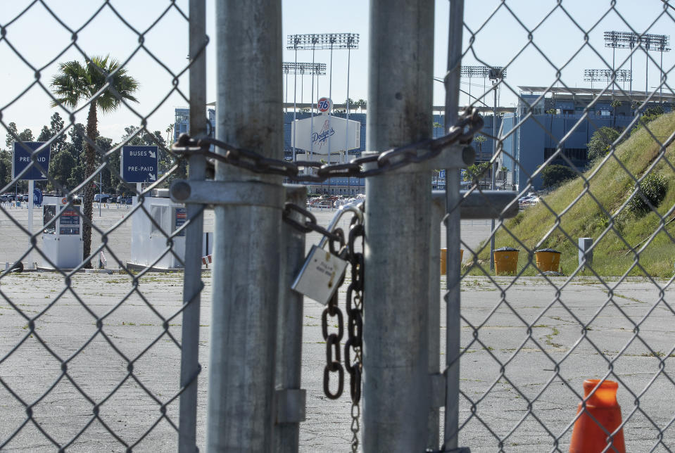 LOS ANGELES, CA-MARCH 26, 2020:  The gates leading to an entrance to Dodger Stadium are locked on what would have been opening day if not for the coronavirus outbreak.   (Photo by Mel Melcon/Los Angeles Times via Getty Images)