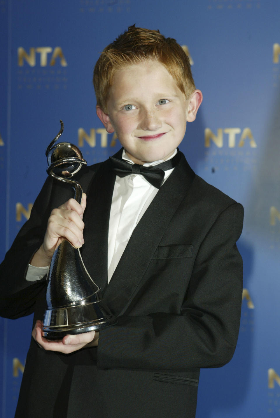 LONDON - OCTOBER 26: Actor Sam Aston poses with his award for Most Popular Newcomer at the 10th Anniversary National Television Awards at the Royal Albert Hall on October 26, 2004 in London. The star-studded awards ceremony awards prizes as voted for by members of the public. (Photo by Dave Hogan/Getty Images)