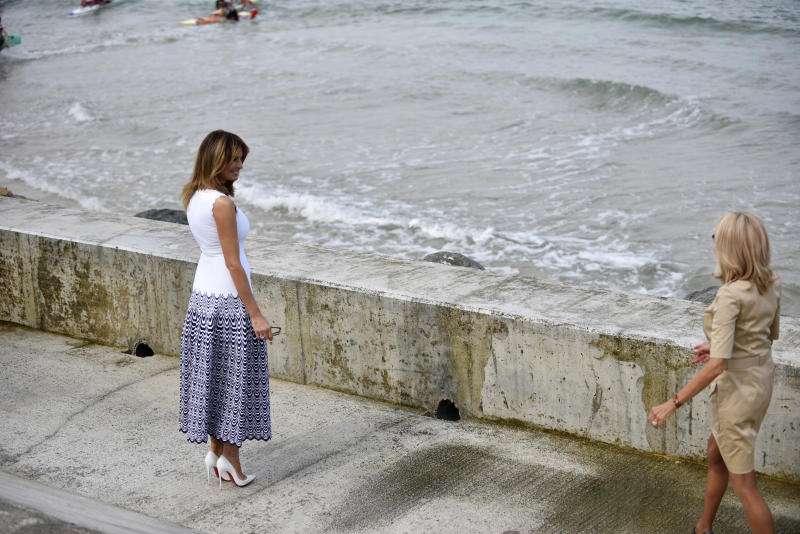 U.S first lady Melania Trump, left, and French first lady Brigitte Macron visit at the Cote des Basques beach during the G7 summit, in Biarritz, southwestern France, Monday Aug. 26 2019. (Julien de Rosa/Pool via AP)
