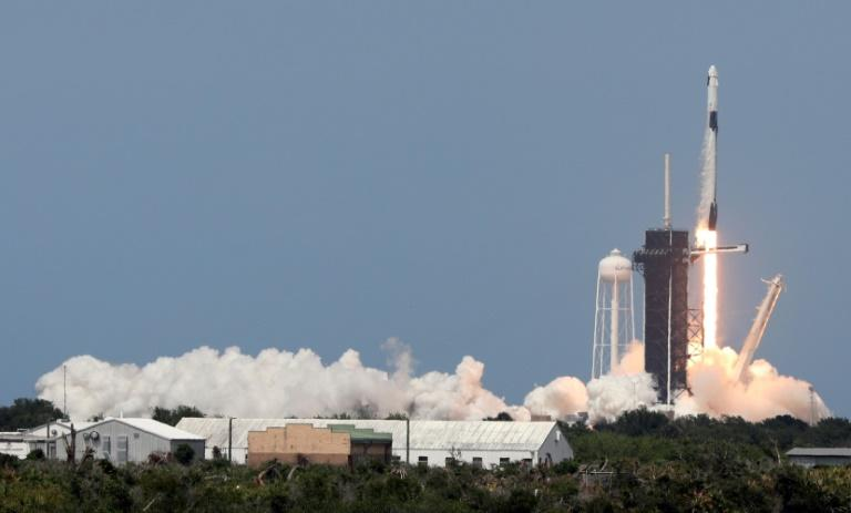 SpaceX's Falcon 9 rocket carrying the Crew Dragon capsule lifts off from launch complex 39A at the Kennedy Space Center in Florida