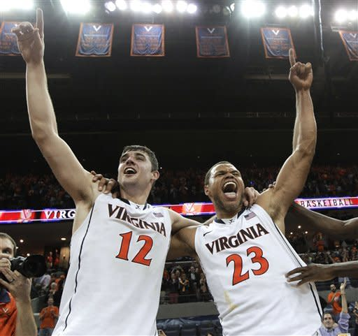 Virginia's Joe Harris (12) and Justin Anderson (23) celebrate Virginia's 73-68 win over Duke in an NCAA college basketball game Thursday, Feb. 28, 2013, in Charlottesville, Va. Virginia won the game 73-68. Harris had 36 points. (AP Photo/Steve Helber)