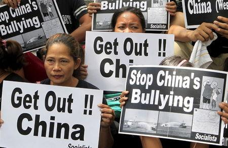Protesters from the Socialista National Confederation of Labor activist group display placards during a rally over the South China Sea disputes with China, outside the Chinese Consulate in Makati City