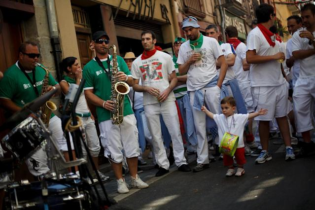 PAMPLONA, SPAIN - JULY 08: A boy reacts while hearing a band playing music in the street during the third day of the San Fermin Running Of The Bulls festival, on July 8, 2013 in Pamplona, Spain. The annual Fiesta de San Fermin, made famous by the 1926 novel of US writer Ernest Hemmingway 'The Sun Also Rises', involves the running of the bulls through the historic heart of Pamplona, this year for nine days from July 6-14. (Photo by Pablo Blazquez Dominguez/Getty Images)