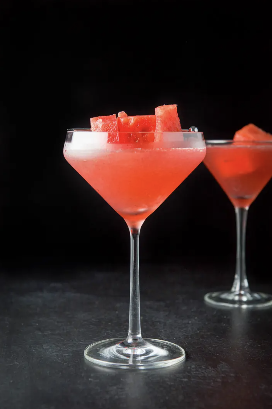 """<p>If you're feeling a little fancy, this watermelon-infused cosmopolitan is for you. Garnish with melon cubes for a pretty effect.</p><p><strong>Get the recipe at <a href=""""https://dishesdelish.com/watermelon-cosmo/"""" rel=""""nofollow noopener"""" target=""""_blank"""" data-ylk=""""slk:Dishes Delish"""" class=""""link rapid-noclick-resp"""">Dishes Delish</a>. </strong></p><p><strong><a class=""""link rapid-noclick-resp"""" href=""""https://go.redirectingat.com?id=74968X1596630&url=https%3A%2F%2Fwww.walmart.com%2Fsearch%2F%3Fquery%3Dmartini%2Bglasses&sref=https%3A%2F%2Fwww.thepioneerwoman.com%2Ffood-cooking%2Fmeals-menus%2Fg32147587%2Fwatermelon-drink-recipes%2F"""" rel=""""nofollow noopener"""" target=""""_blank"""" data-ylk=""""slk:SHOP MARTINI GLASSES"""">SHOP MARTINI GLASSES</a><br></strong></p>"""