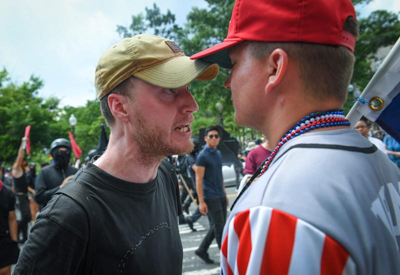 "Members of the Proud Boys, an extremist group with ties to White Nationalism, gather during a ""Rally for Free Speech"" while counter-protestors organized by ""All Out D.C"" oppose the event on July 6, 2019 in Washington."
