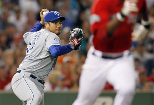 Kansas City Royals' Bruce Chen, left, throws to first base for the out on a ground ball by Boston Red Sox's Pedro Ciriaco, right, in the fifth inning of a baseball game in Boston, Friday, Aug. 24, 2012. (AP Photo/Michael Dwyer)